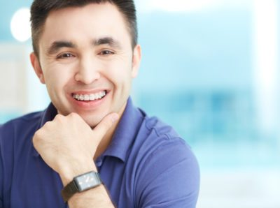 Man with nice teeth smiling after orthodontic procedure