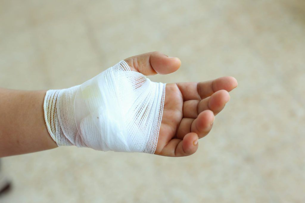 Cut made through the skin and soft tissue to facilitate an operation